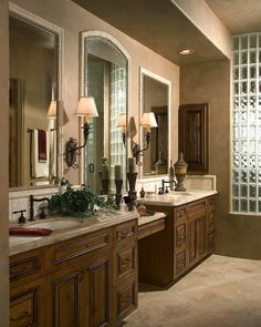Have a long vanity?  No need for an outdated, expensive, large mirror... dividing the space with smaller mirrors adds interest, elegance, and direction.  VG