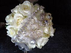 Ivory avalanche roses and silver jewellery decoration