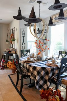 Halloween decorating doesn't have to be complicated or expensive. We are sharing our easy and affordable Halloween decor ideas! We decorated ours with floating witch hats, autumn leaf garlands and buffalo plaid. Rustic Halloween, Farmhouse Halloween, Halloween Porch Decorations, Halloween Table, Halloween Home Decor, Outdoor Halloween, Fall Home Decor, Autumn Home, Holidays Halloween