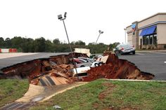 A cave-in of a restaurant parking lot in Mississippi swallowed 12 cars and now experts are expected to begin work Monday to determine the cause of the weekend collapse, authorities said. Parking Lot, Car Parking, International House Of Pancakes, Japan Earthquake, World Trade Center, Open Up, Car Insurance, Around The Worlds, Vehicles