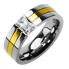 Wonderfully modern design in two-tone titanium, with a mirror polished ring highlighted with a 14K gold ion plated band and a floating emerald cut CZ. For men and women. Perfect for couples.  Wholesale Titanium Rings & Wedding Bands. www.925express.com