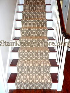 Our most recent custom hall and stair runner project uses a broadloom material. The pattern is a David Hicks design, Hexagon House. John meticulously cut the material to nicely balance the pattern.