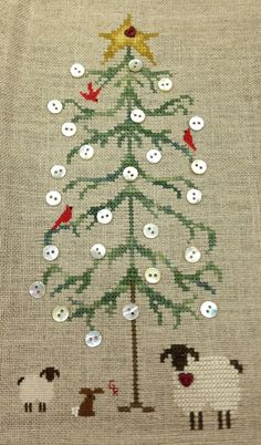 Gladys added buttons to her tree. Suwannee valley cross stitch.  Pattern available.  Sallyxstitch@mindspring.com