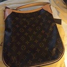 Louis Vuitton Oden PM Louis Vuitton Odeon PM. Excellent condition. Includes original receipt, LV dust bag. Trim and leather in great condition. Handbag has been carried two-three times. Stored in original dust bag. Clean inside: no stains, tears or rips. TRADES/PRICE. This bag is listed on LV site for $1120 plus taxes. Date Code: SF2123/ Measurements: 10.2 x 11.4 x 2.8 inches  (Length x Height x Width) Louis Vuitton Bags Crossbody Bags