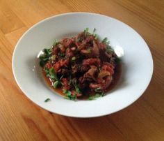 Braised squid with tomatoes, garlic and parsley.