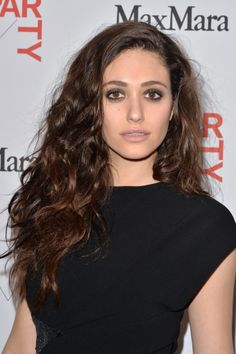 Emmy Rossum mastered the art of bedhead hair at the Whitney Art Party, and the smoky eye was a the ideal complement for the dramatic hairstyle.