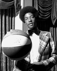 """Dr. J-  is known for helping bring about the modern style of basketball, which is played largely above the rim. He made many different moves famous such as the no-look pass and cross over dribble. Erving also made the """"slam"""" dunk famous. Another move that defined his career and improved basketball. Although most of his career was spent in the now disbanded ABA, he won three championships, four MVP awards and three scoring titles. He is the fifth highest-scoring player in NBA history."""
