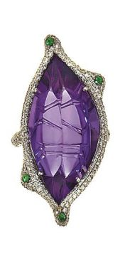 An amethyst, diamond and gem-set ring  The fancy-cut stylised navette shaped amethyst to pavé brilliant-cut diamond surround, openwork gallery and shoulders with green gem accents.