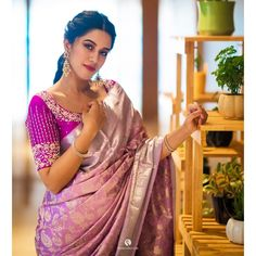 This pashudh saree is in tender lavender shade filled with cream mango paisleys and floral creepers on the body. The border is richly filled with silver zari adorned by vanasingaram enhances the kanjeevaram look. The pallu is elaborated with rich silver zari patterns. Paired with self color beautiful blouse.