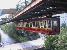 This is the only train in the world that runs like this! It's in Germany in Wuppertal next to Remscheid. love to ride it ,it´s like flying :-) By Train, Train Tracks, Places To Travel, Places To See, Tramway, Bonde, S Bahn, Train Pictures, Light Rail