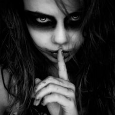 "'Shh  by *Zaratops' (sarahlovenphotography) #deviantart -- Daily Deviation 2009-12-17: ""Sometimes horror can be found lurking in the realm of potential and intent, in emotions portrayed silently, in the look in someone's eyes. Shh by *Zaratops is doom wrapped in beauty."" #PhotographyIlike"