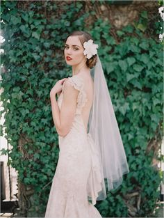Claire Pettibone Dress and love this hairstyle/veil. lovely (: