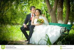 Bride and groom on bench | Bride and groom in a park sit on the bench in a beautiful day.