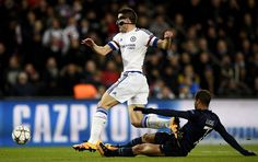 Chelsea's Spanish defender Cesar Azpilicueta vies for the ball with Paris Saint-Germain's Brazilian midfielder Lucas Moura during the Champions League round of 16 first leg football match between Paris Saint-Germain and Chelsea FC on February 16, 2016, at the Parc des Princes stadium in Paris.
