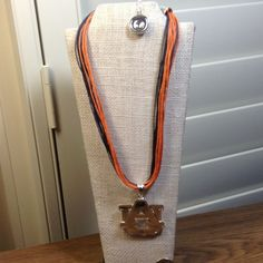 """Orange and Blue / silver tone Auburn Necklace Auburn Necklace Approx 16 """" or 17"""" long. Orange and blue strands with silver tone UA hanging on it. Never been worn. Made in China.  Does have the seal from university. seasons Jewelry Necklaces"""