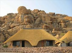 In the heart of Namibia lies a special wilderness area, encircled by the Erongo Mountains, where the desert, mountain, and bushveld ecosystems combine South African Homes, African House, Hut House, Dome House, Round House Plans, Small House Plans, Thatched House, Thatched Roof, Flat Roof House
