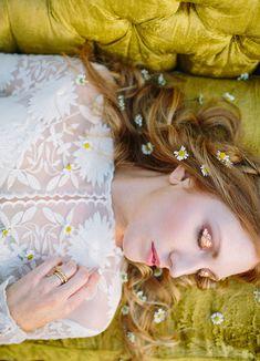 Copper eyeshadow + daisies in her hair