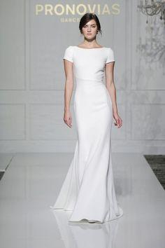 41 Edgy Modern Wedding Ideas You'll Love: sheath short sleeve simple wedding dress for a minimalist bride