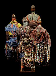Africa | Five dolls from the Namji people of Cameroon | Wood, cowrie shells, glass beads, metal and leather | ca. 19th - 20th century