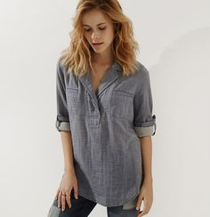 Slouchy and cool with in cotton doublecloth, we love this artful take on shirting. Notched lapel with button-through tab collar. Long sleeves. Patch pockets. Button cuffs. Back yoke. Shirttail hem.