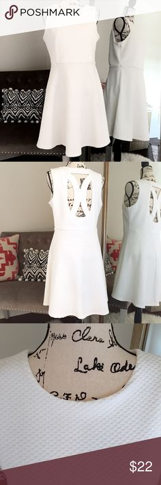 White skater dress Looking for the perfect spring dress? Look no further! Figure flattering with cut out back makes this the perfect little number ❤ Dresses