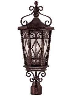Showcasing ornate scrollwork details and a new tortoise shell finish, this striking post lantern is perfect for illuminating your front walk in style. Porch Lighting, Outdoor Lighting, Lantern Lighting, Lighting Ideas, Mediterranean Wall Sconces, Lamp Post Lights, Outdoor Post Lights, Lantern Set, Tuscan Decorating