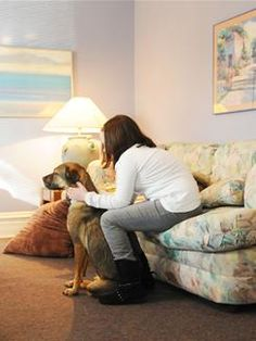 Ellen Kinney works with her certified therapy dog, Sasha, in counseling a young patient. Kinney said their work with the young girl has helped in developing her confidence and assertiveness.
