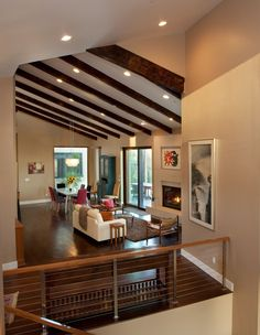 Vaulted wooden ceiling beams in a living room by G.J. Gardner Homes.