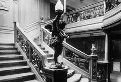 Staircase of the Titanic {note the cherub lamp) LOVE THIS... history in photos amazes me..
