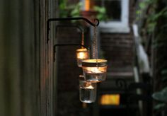 How To Make A Hanging Mason Jar Sconces The Easy Way. Are you a fan of mason jars or are trying to find creative ideas with mason jars? For those of you who do not know what mason jars are,… Continue Reading → Mason Jar Sconce, Hanging Mason Jar Lights, Hanging Candles, Mason Jar Candles, Mason Jar Lighting, Diy Hanging, Kitchen Lighting, Pot Mason Diy, Landscape Lighting Design