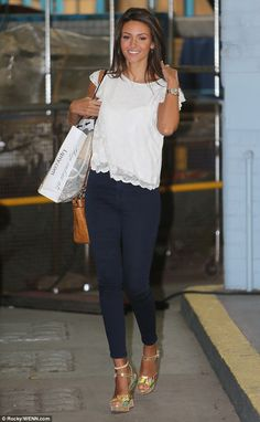 Golden: Michelle displayed a deep tan shortly after arriving in a short sleeved top with a scalloped hem shortly after arriving at ITV studios ahead of her interview on Tuesday morning