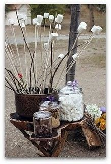 Kinda like this idea.  We're thinking galvanized buckets instead of glass jars.  also tying the smore baggies on the sticks.