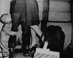 """""""A youngster, clutching his soldier father, gazes upward while the latter lifts his wife from the ground to wish her a 'Merry Christmas.' The serviceman is one of those fortunate enough to be able to get home for the holidays."""" December World War Two Christmas Past, Vintage Christmas, Christmas Photos, Christmas History, Vintage Love, Vintage Photos, Vintage Couples, Vintage Beauty, Soldiers Coming Home"""