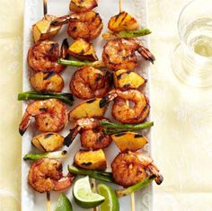Grilled Shrimp and Peach Kabobs are so EASY! Simply skewer seasoned shrimp, fresh chunks of peach and green onion, then grill for 3-4 minutes. Delicious AND nutritious! #eatwellfestfoods