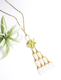 """""""Everlasting Summer"""" - 1960's daisy brooch layered over a mid century goldleaf paired with 1950's white fringe pendant."""