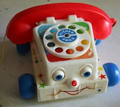 1980's Toys - Fisherprice Telephone...kids today wouldn't even know what the hell this is....I might still have this in the attic
