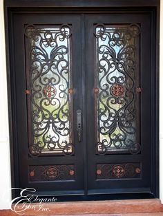 Custom wrought iron front door with scrollwork and medallions on footboard. & Custom wrought iron front door with scrollwork and medallions on ...