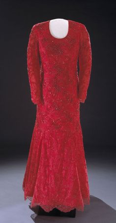 Laura Bush wore this ruby-red gown of crystal-embroidered Chantilly lace over silk georgette to the 2001 inaugural balls. A sketch and description of the dress was released to the press two weeks before the inauguration. The dress was designed by fellow Texan Michael Faircloth. Some reports speculated that Faircloth encouraged the normally conservative Mrs. Bush to choose the brilliant color.