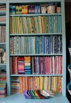 Shelves of Sorted Fabric - How to Display Your Fabric Stash they suggest using acid free comic book boards to store your fabric. found them online for $10.99 for 100 boards - quite a bit cheaper than the boards that I have sen advertised in quilting mags!!