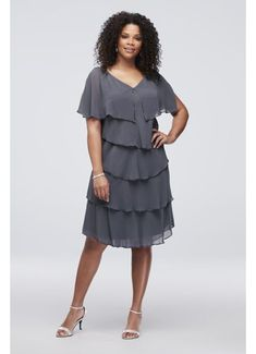 1a35ec9d298 This tiered chiffon plus-size cocktail dress is a fun and fluttery choice  for the mother of the bride. By SLNY Polyester Pullover styling