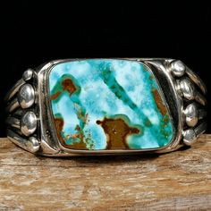 Pilot mountain turquoise with amber matrix set in sterling silver by Orville Tsinnie (Navajo)