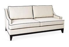 A chic white & black sofa for your library.