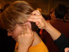 Helping each other Ear Reflexology. www.AmericanAcademyofReflexology.com