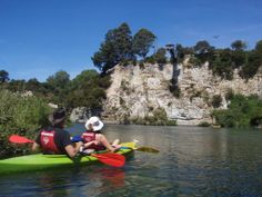 Kayaking is a great way to explore remote areas... and in this case not so remote areas - there are people bungy jumping off those cliffs ahead! Waikato River, New Zealand