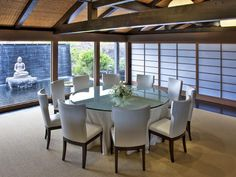 Japanese inspired Dining Room.  Love round tables in larger spaces...breaks up al the straight lines