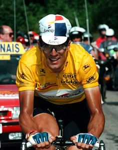 """Spain's Miguel Indurain, born on July 16, 1964, was the dominant Grand Tour rider in the 1990's with seven victories in the Grand Tours. He won five consecutive wins (1991 through 1995) in the Tour de France, Indurain being the first to accomplish this feat.  """"Big Mig"""" also won the Giro d'Italia twice, in 1992 and 1993, which gave him the victories in the Tour / Giro during those two years."""