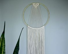 Dreamy handmade macrame wall hanging, made with 3mm natural white cotton rope and a 6 brass ring. Features a sleek modern design and long fringe. Measures approx. 35 total length. Would make a lovely gift! *NEW* hand dyed black rope is now available! (Please note: as this is hand dyed, this is not a pure dark black!) This item is MADE TO ORDER! Please allow 1-3 business days for production. ✦ 10 Ring Version ✦ www.etsy.com/listing/257348579 ✦ 14 Ring Version ✦ www.etsy.com/listing/453038026