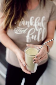 A breastfeeding shake recipe from some of my favorite ingredients that are known to help with milk production. Read on for my 5 Breastfeeding Tips and Lactation Smoothie Recipe that will help make breastfeeding your babies easier. |  Lactation Smoothie Recipe by popular Florida mommy blog, Fresh Mommy Blog: image of a mom holding a lactation smoothie.