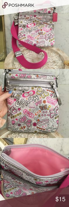 Coach Crossbody Bag Never used! Imitation coach, looks real. Really cute for young girls. Pink strap and pink interior. Strap is adjustable. Few pockets on outside. Bags Crossbody Bags