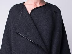 Whether you dress it up or down, the asymetric overlap front opening on this coat givesyou the option to wear itin so many different ways.Crafted from yak and Merino wool, ablack lambskin trim finishescalates the luxury into a style with distictive edge.